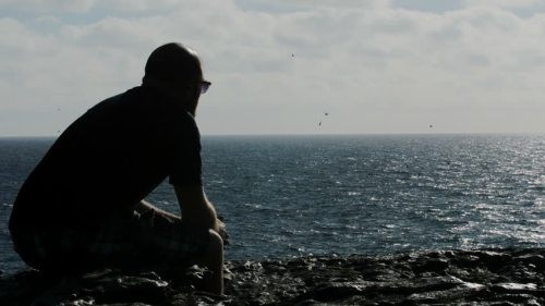 Lost in thoughts at the sea