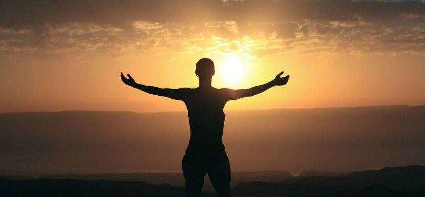 WhatsApp man stretching arms sunrise