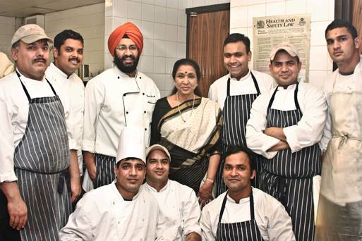 Wikipedia says that Asha Bhosale personally trains her chefs. 2013 pic from Asha's Facebook page